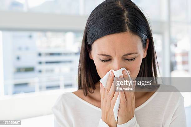 Close-up of a woman sneezing