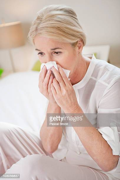 Close-up of a woman suffering from cold