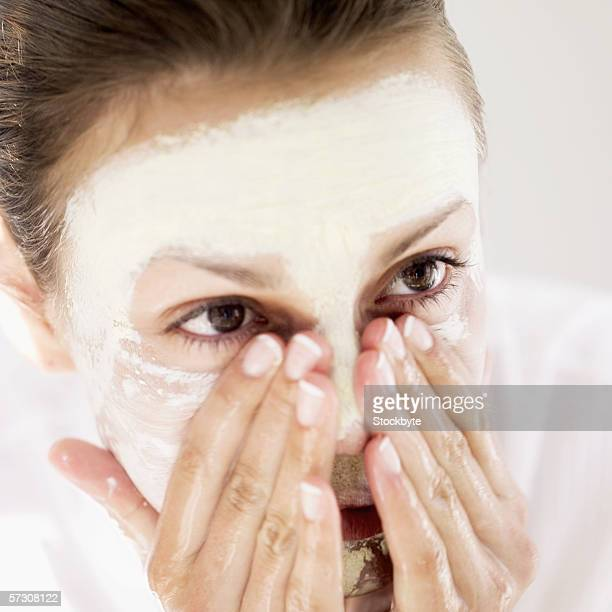 Close-up of a woman washing off face pack
