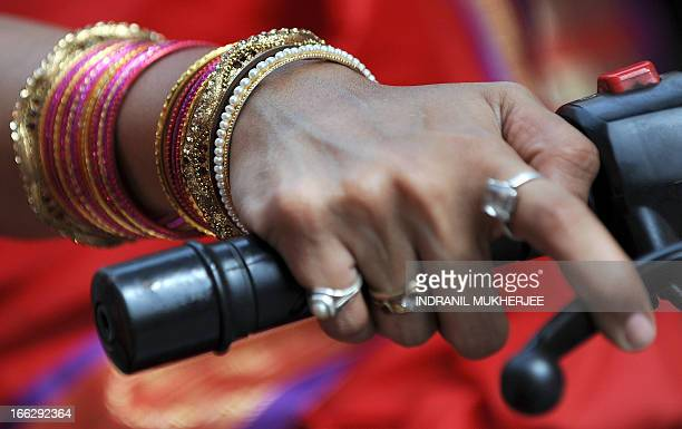 A closeup of a woman wearing traditional jewellery is seen on a motorcycle during a procession celebrating 'Gudi Padwa' or the Maharashtrian new year...