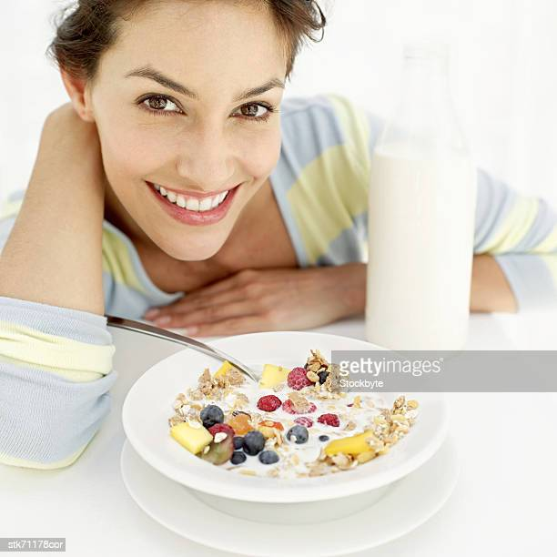 Close-up of a woman with a bowl of breakfast cereal
