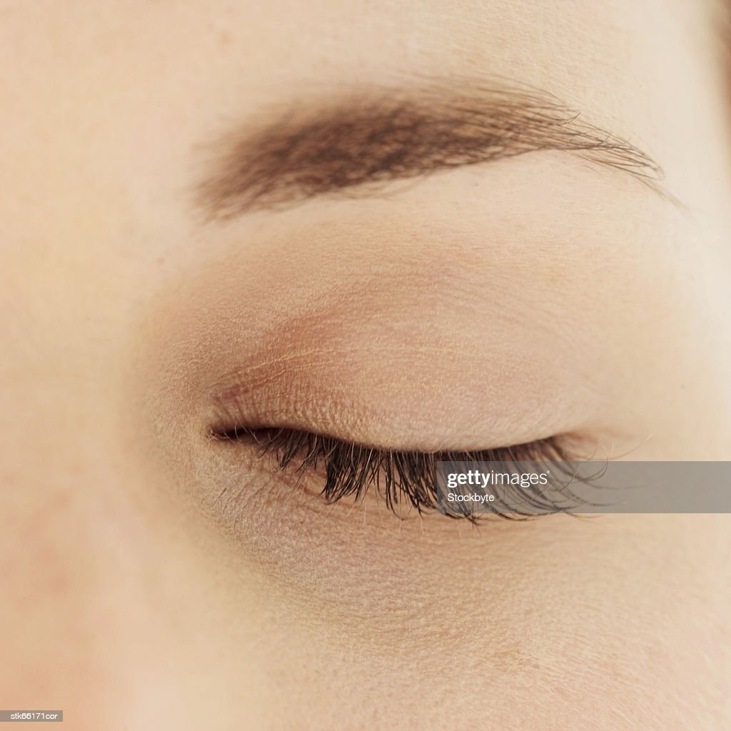 close-up of a woman's eye closed : Stock Photo