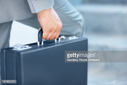 Close-up of a young businessman carrying briefcase