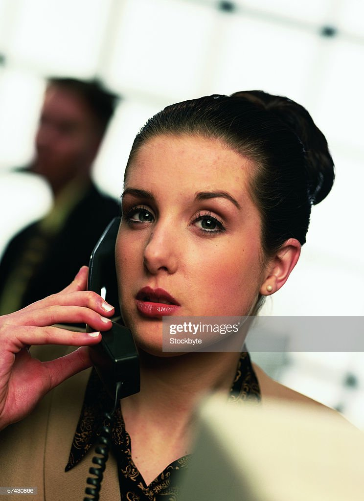 Close-up of a young businesswoman talking on telephone : Stock Photo