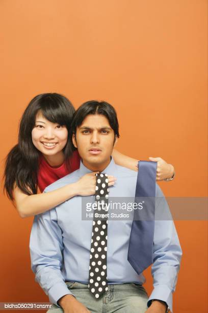 Close-up of a young couple choosing a tie