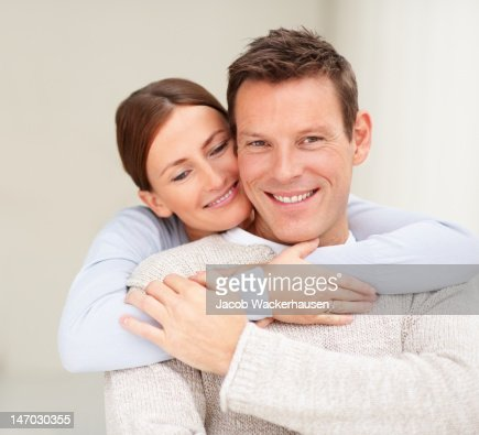 Close-up of a young couple smiling and embracing