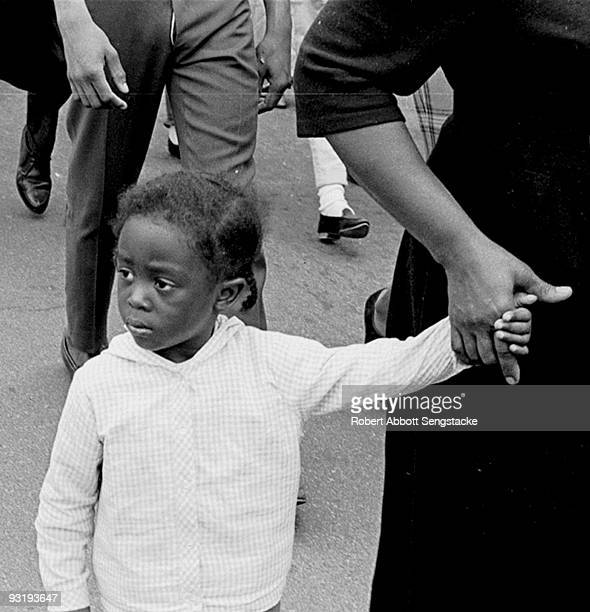 Closeup of a young girl as she holds hands with a woman during on the Selma to Montgomery marches held in support of voter rights Alabama late March...