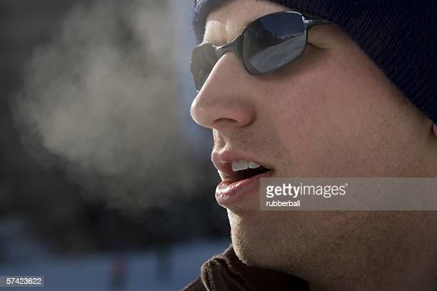 Close-up of a young man outdoors in winter