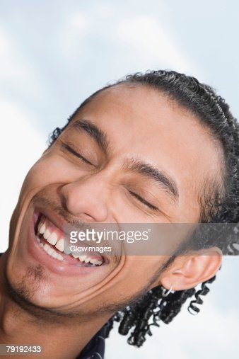 Close-up of a young man smiling : Stock Photo