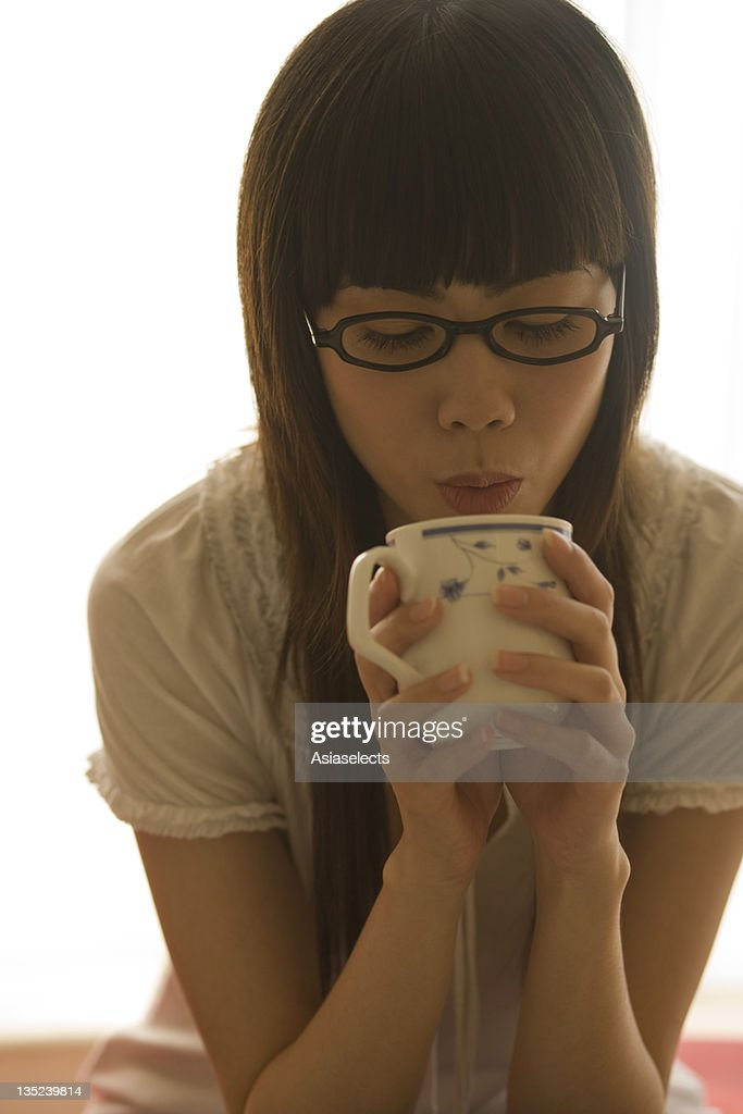 Close-up of a young woman drinking tea
