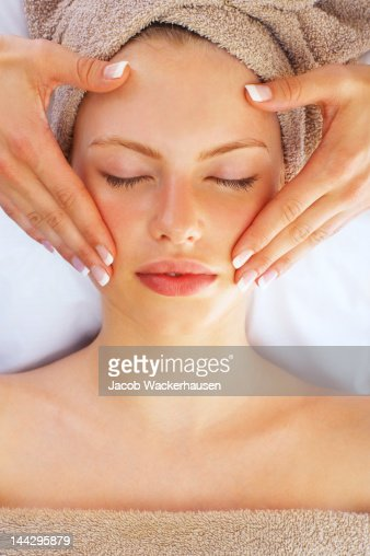 Close-up of a young woman getting spa treatment