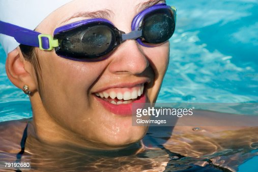 Close-up of a young woman in a swimming pool : Stock Photo