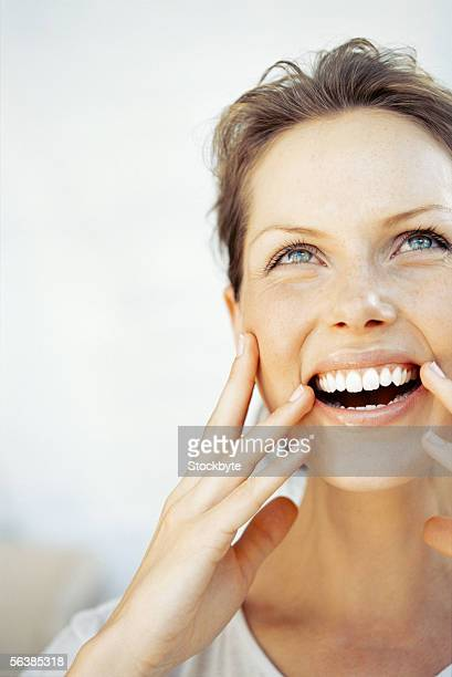 close-up of a young woman laughing