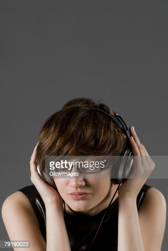 Close-up of a young woman listening to music : Stock Photo