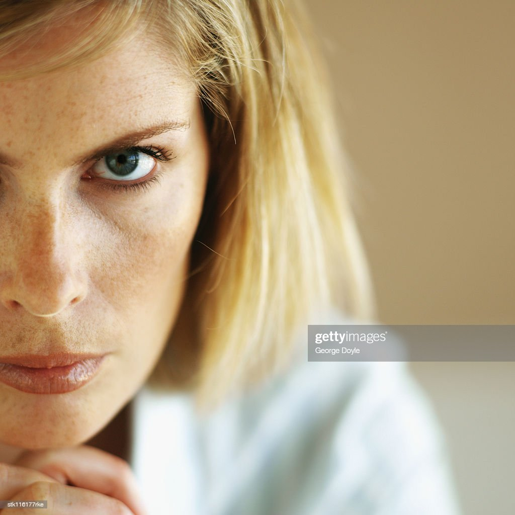 Close-up of a young woman looking at camera : Stock Photo