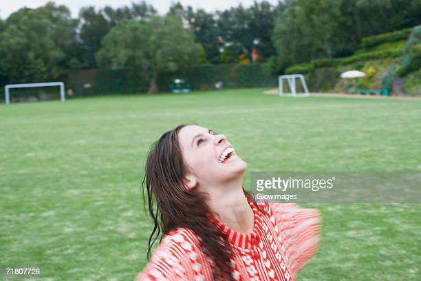 Close-up of a young woman looking up in a playing field