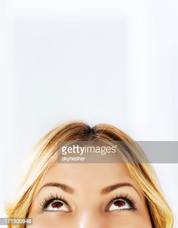 Close-up of a young woman looking up