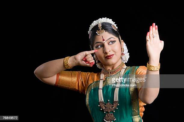 Close-up of a young woman performing Bharatnatyam