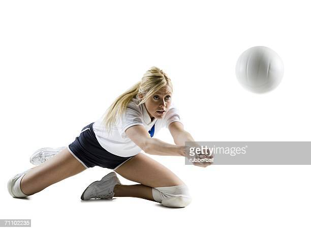 Close-up of a young woman playing volleyball