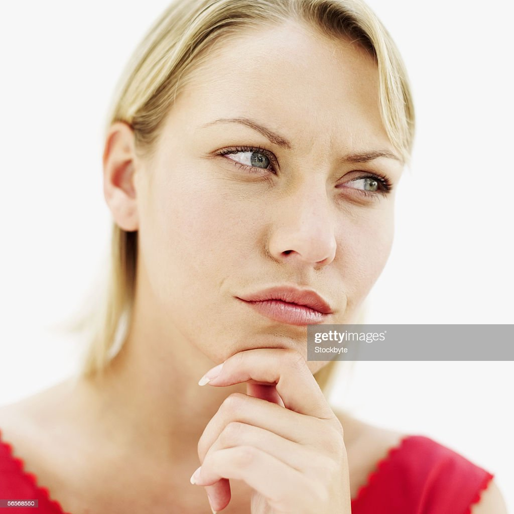 close-up of a young woman with her hands on her chin : Stock Photo