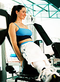 Close-up of a young woman working out at a gymnasium