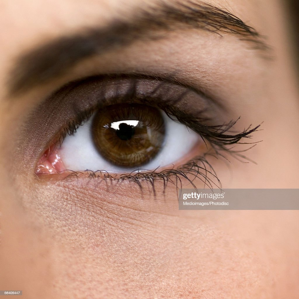 Close-up of a young woman's eye : Stock Photo