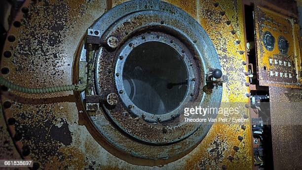 Close-Up Of Abandoned Washing Machine At Laundromat