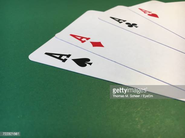 Close-Up Of Ace Cards On Table