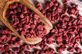closeup of achiote seeds used for natural coloring