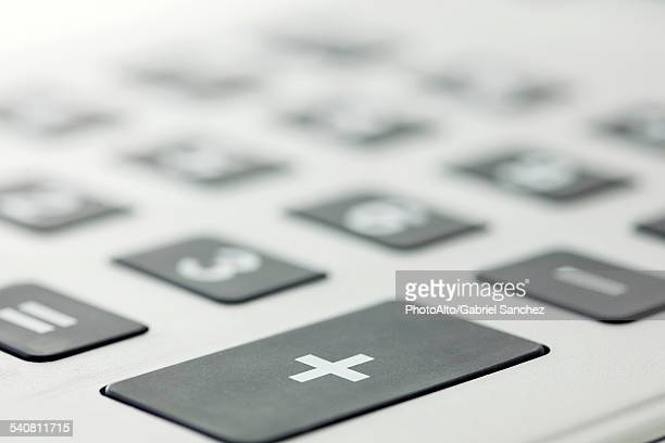 Close-up of addition button on calculator