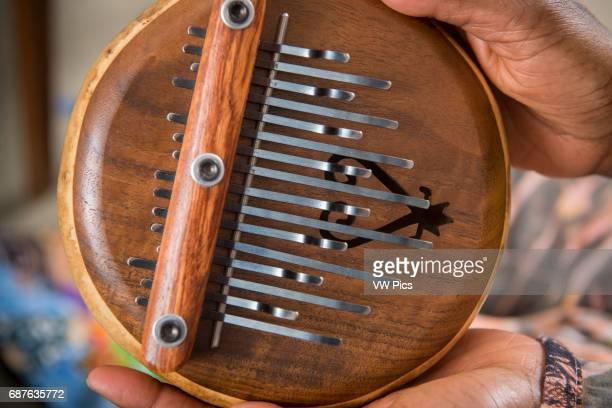 Closeup of African American hands holding a lamellophone musical instrument