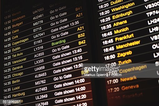 Close-Up Of Airport Departure Board Showing Gate Numbers With Flight Times