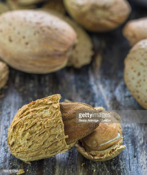 Close-Up Of Almonds On Wood