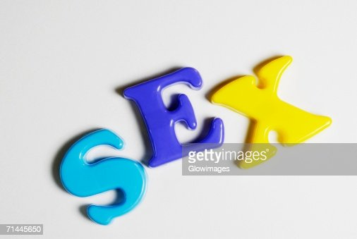 Close-up of alphabets spelling the word sex