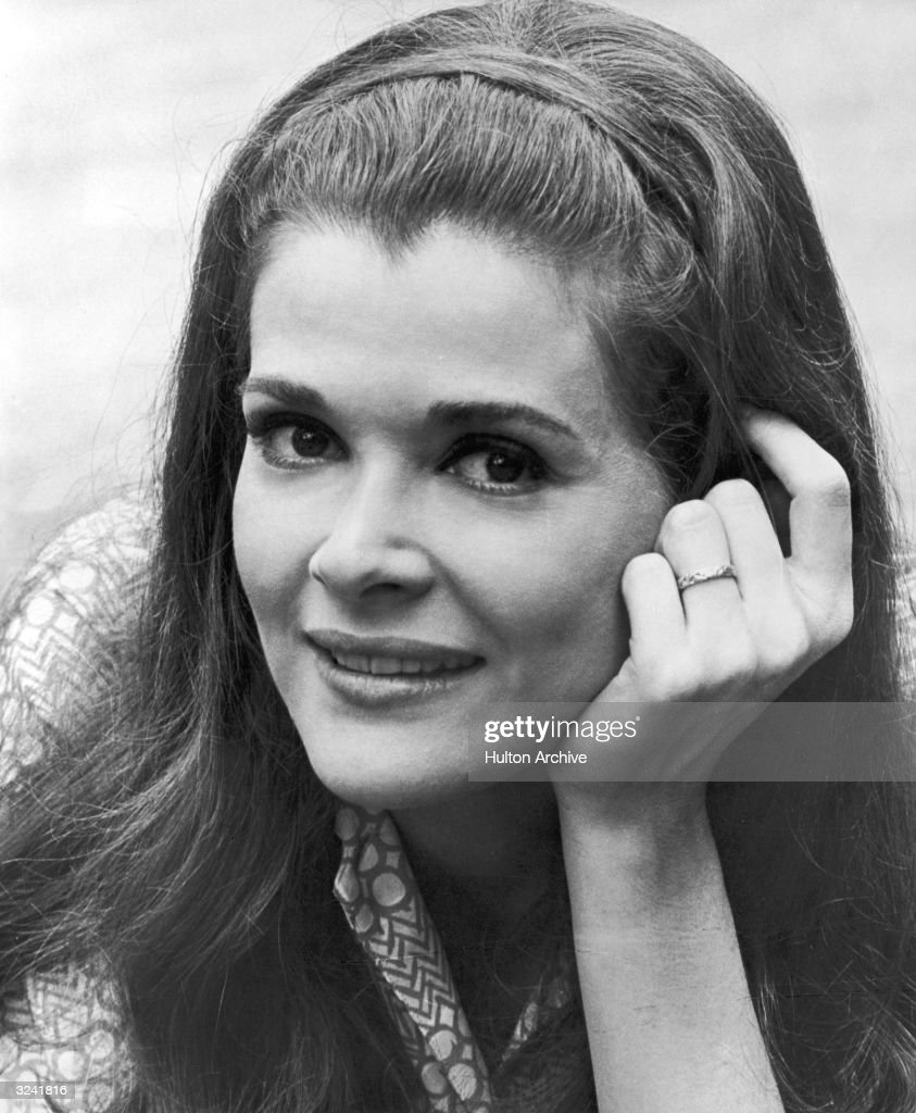 Closeup of American actor Jessica Walter smiling with her hand against her cheek in a promotional portrait from director John Frankenheimer's film...