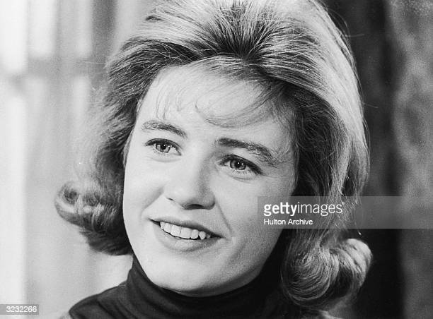 Closeup of American actor Patty Duke smiling in a still from the television series 'The Patty Duke Show'