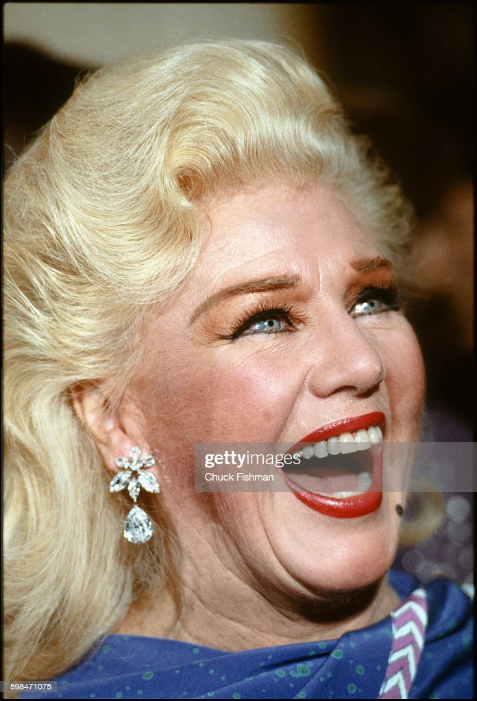 Close-up of American actress, dancer, and singer <a gi-track='captionPersonalityLinkClicked' href=/galleries/search?phrase=Ginger+Rogers&family=editorial&specificpeople=93466 ng-click='$event.stopPropagation()'>Ginger Rogers</a> (born Virginia McMath, 1911 - 1995) as she laughs during an unidentified event at the Kennedy Center, Washington DC, December 1979.