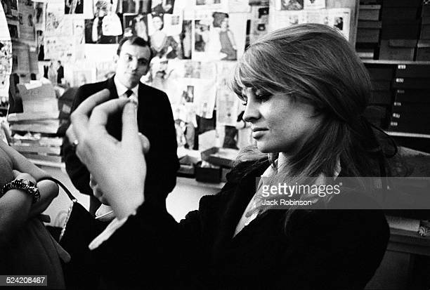 Closeup of American actress Julie Christie as she shops in an unidentified boutique New York New York January 1966