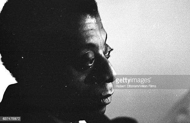 Closeup of American author and playwright James Baldwin as he sits backstage at the ANTA Playhouse New York New York April 1964 He was there to...