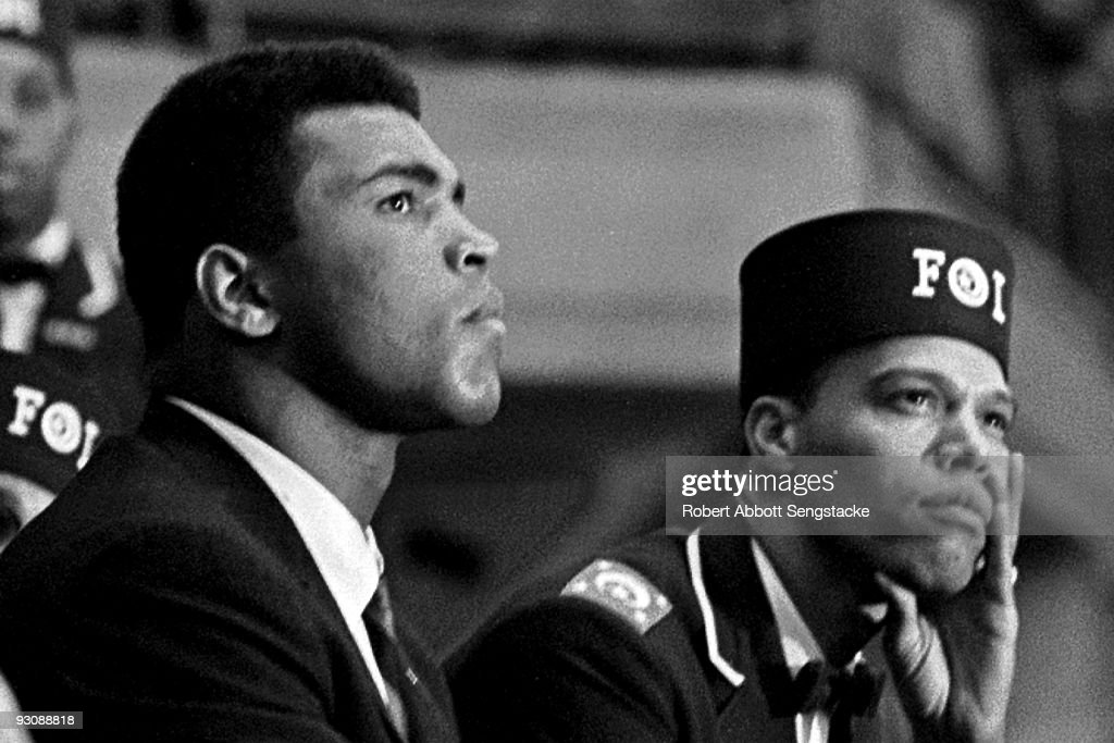 Close-up of American boxer <a gi-track='captionPersonalityLinkClicked' href=/galleries/search?phrase=Muhammad+Ali+-+Boxer+-+Born+1942&family=editorial&specificpeople=93853 ng-click='$event.stopPropagation()'>Muhammad Ali</a> (born Cassius Clay) (left) and Nation of Islam leader <a gi-track='captionPersonalityLinkClicked' href=/galleries/search?phrase=Louis+Farrakhan&family=editorial&specificpeople=215023 ng-click='$event.stopPropagation()'>Louis Farrakhan</a> (born Louis Walcott) as they listen to a speaker during the Saviour's Day celebrations at the International Ampitheatre, Chicago, Illinois, February 27, 1966. Farrakhan wears a Fruit of Islam uniform, a subset of the Nation of Islam.