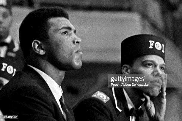 Closeup of American boxer Muhammad Ali and Nation of Islam leader Louis Farrakhan as they listen to a speaker during the Saviour's Day celebrations...