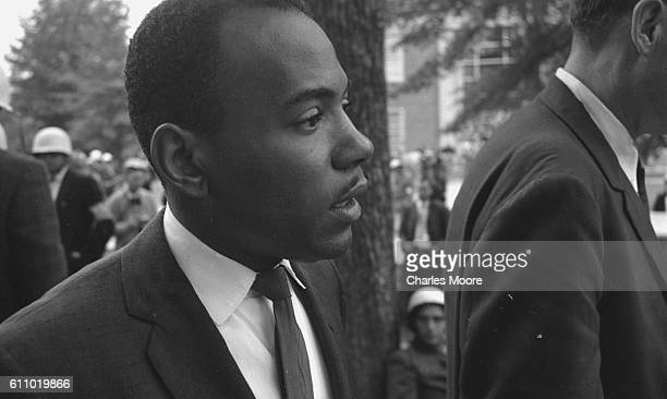 Closeup of American Civil Rights activist and student James Meredith as he is escorted by US Marshals and various officials on his way to register...