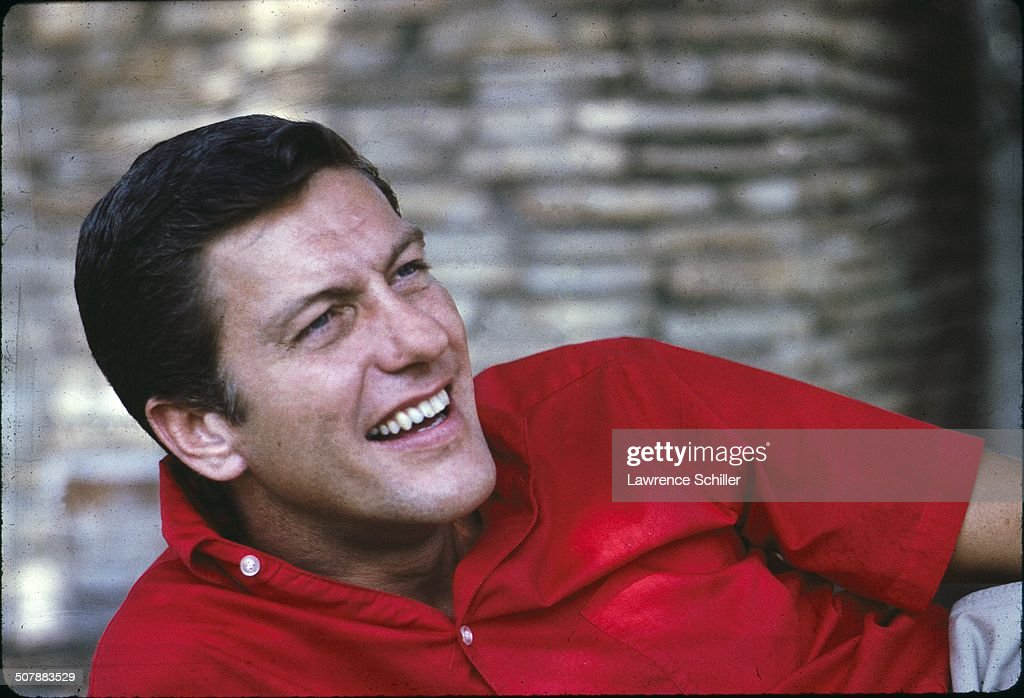 Closeup of American comedian and actor Dick Van Dyke in a red shirt 1963