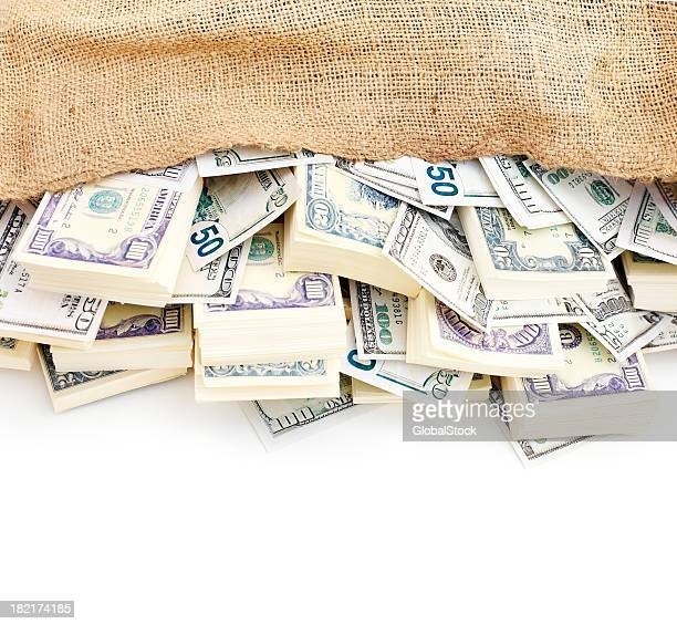 Closeup of American dollars in a jute sack