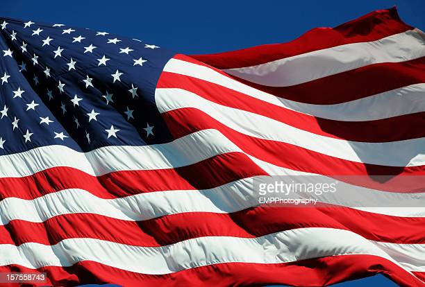 Close-up of American flag fluttering in the breeze