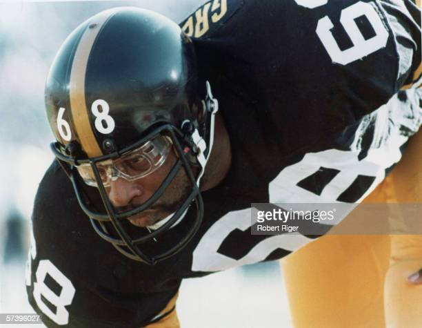 Closeup of American football player LC Greenwood of the Pittsburgh Steelers as he crouches on the field eyeing his opponant 1970s