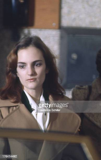 Closeup of American heiress Patty Hearst as she is escorted from her holding cell during her trial for her role in the robbery of the Sunset District...