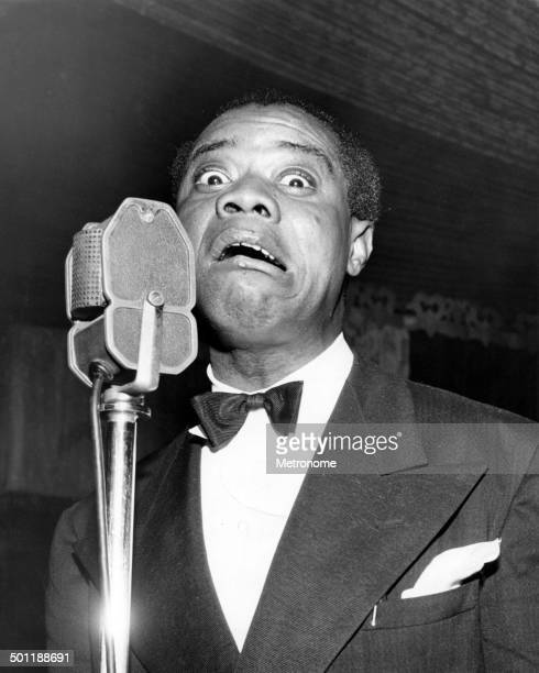 Closeup of American jazz musician Louis Armstrong as he performs at the Trianon Ballroom Los Angeles California January 26 1945