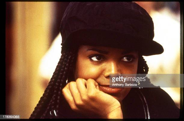 Closeup of American singer and actress Janet Jackson on the set of her film 'Poetic Justice' 1993
