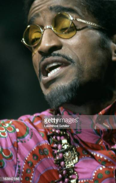 Closeup of American singer dancer and actor Sammy Davis Jr as he performs in a scene from the film 'Sweet Charity' at Universal Studios Los Angeles...
